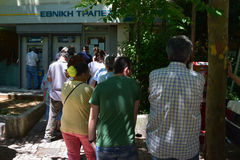 Line of people greek bank Stock Photo