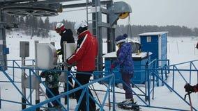 Line of people ski lift stock video