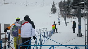 Line of people ski lift stock video footage