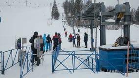 Line of people ski lift stock footage