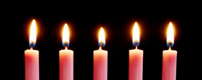 Line of pink candles stock photos