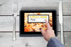 On-line pizza ordering and delivery concept Stock Photo