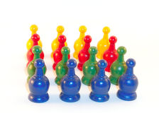 Line of playing pieces. Game pieces from an old game standing in formation Stock Image