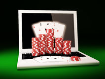 On line poker. Gambling chips and poker cards on a laptop Stock Images