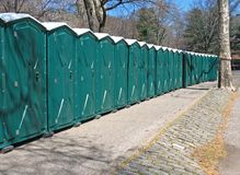 Line of portable toilets Stock Images