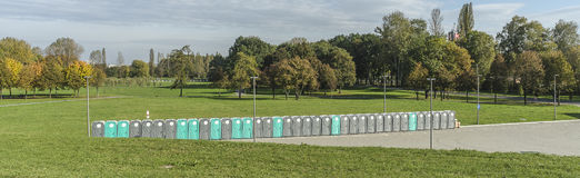 Line of Portable Toilets. In the park . On parking lot next to the Sports Hall Tauron Arena in Krakow , Poland royalty free stock photos