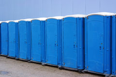 Line of portable toilets Royalty Free Stock Images