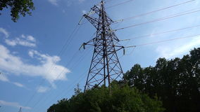 Line of power transmission towers near the city, moving camera stock video