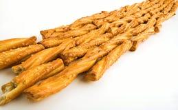 Line of pretzels. Line of prezel braids on white stock photo