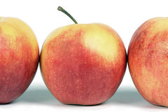 A line of red apples. A close up stock photography