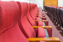 The line of red armchair in the auditorium Royalty Free Stock Photos