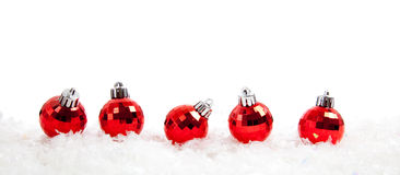 Line of Red christmas balls on snow Stock Photo