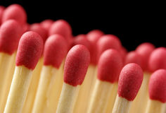 Line of red matchsticks on black background Royalty Free Stock Images
