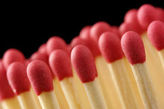 Line of red matchsticks on black background Royalty Free Stock Photo
