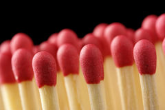 Line of red matchsticks on black background Stock Photo