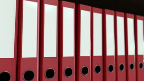 Line of red office binders. 3D rendering. Line of red office binders Royalty Free Stock Images