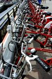 Line of Red and White Bicycles Stock Photos