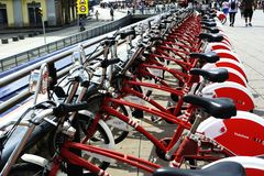 Line of Red and White Bicycles Stock Images