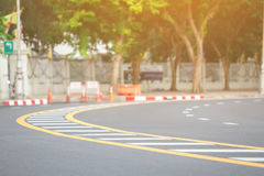 Line on road. Yellow and white traffic line on the curve road Royalty Free Stock Photo