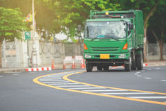 Line on road. Yellow and white traffic line on the curve road white blur green truck Royalty Free Stock Photography