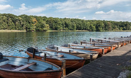 A line of rowing boats on a lake shore Royalty Free Stock Photo