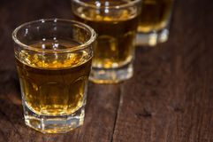 Line of Rum Shots on wooden background Royalty Free Stock Image
