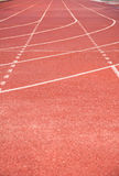 Line on running track with rubber cover royalty free stock photography