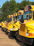 Line of School Buses. A line of school buses await drivers for their routes Stock Photo