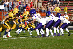 Line of scrimmage. In american football game. University league teams, no trademarked logos or other copyrighted content Royalty Free Stock Images