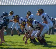 Line of scrimmage at a football game stock photo