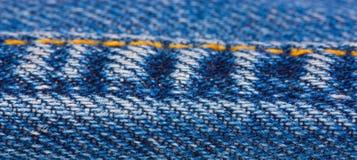 Line seamstress blue jeans Stock Image