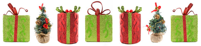 Line of seven Christmas gifts Royalty Free Stock Photography