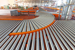 Line shaft rollers. Conveyer roller sorting system in distribution warehouse Stock Images
