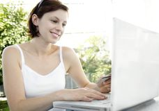 On-line Shopping. Young woman enjoys On-line Shopping Stock Images