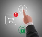 On line shopping. Hand pushing virtual symbol PLUS , on line shopping Royalty Free Stock Image