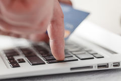 On-line shopping on the internet using a laptop Stock Photography