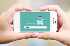 On line shopping on smart phone screen, E-commerce Stock Image