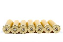 Shotgun shells. A line of shotgun shells on white Royalty Free Stock Photos