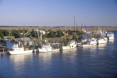 A line of shrimp fishing boats in the Intercoastal Waterway in Northern Carolina Royalty Free Stock Photo