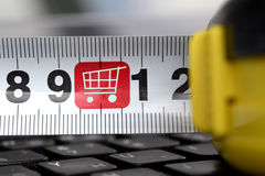 Line and silhouette shopping carts on the keyboard . Royalty Free Stock Photography