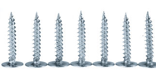 Line of silver screws toned grey Stock Image