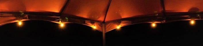 Panorama string lights casting orange glow royalty free stock images
