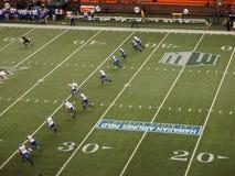 Line of SJSU players begin to run as they Kicks off the football Stock Image