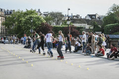 In-line skaters performing for a crowd, Paris, France Stock Images