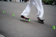 In-line skating slalom Stock Photos
