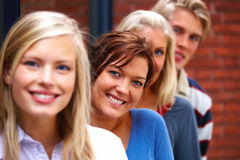 Line of smiling teenagers standing together Royalty Free Stock Photo