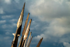 Line of spears in the sky before battle. A line of spears on the sky before a battle or a knights tournament royalty free stock photo
