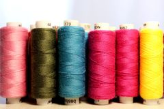 Line of spools of different colors of thread royalty free stock photos