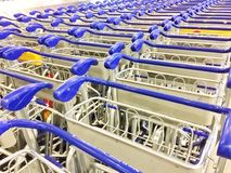 Line stack of trolleys in the airport Royalty Free Stock Photos