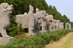 Line of Statues at Song Dynasty Tombs, China. Stone Statues including Horses and Stable Boys guarding the Sacred Way at North Song Dynasty Imperial Tombs, Gongyi Stock Image